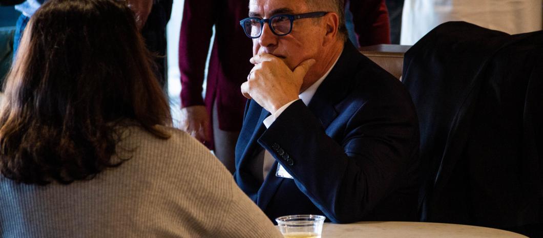 Bruce Milne listens to an entrepreneur